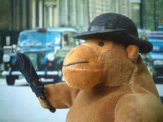 Clipart 3d Chubby Blue Bird In A Bowler Hat Holding An Umbrella